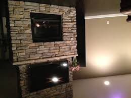 as for the heat comment if you have a mantle inbetween the fireplace and the tv it will deflect the heat outwards and the tv will not be affected