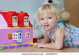 blonde child playing at home ile ilgili görsel sonucu