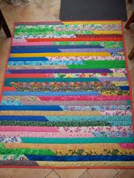 How to Make a Jelly Roll Quilt: 49 Easy Patterns | Guide Patterns & Jelly Roll Race Quilt Directions Adamdwight.com