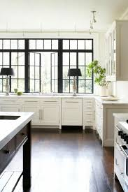 white kitchen windowed partition wall: but i will do a counter to ceiling polished troweled plaster wall and beautiful lamps i love the simplicity of this kitchen nearly nothing on the