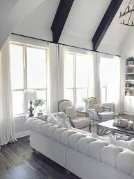 living room window panels. another thing i had to consider when chosing my window treatments was the hardware. chose black finish curtain rod tie in with dark wood and living room panels