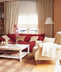 living room with dark sofa. red couch living room of dark brown sofa with r