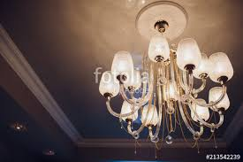 close up of a beautiful crystal chandelier beautiful chandelier luxury expensive chandelier hanging under