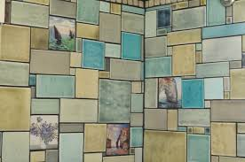 impressionist art tiles inserted into shower