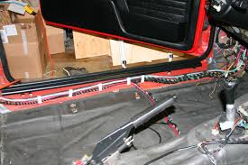 best way to run speaker wiring the entire interior is covered 1 2 layers of damplifier 2 on the floor in doors as well as the rear bulkhead and then a layer of 1 8 closed cell