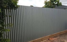 grey corrugated metal fence