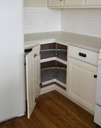 accordion kitchen cabinet doors fresh installing pie cut hinged doors for lazy susan corner cabinet