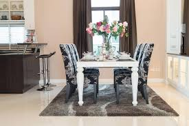 black and white dining table set: pink back and white are the colors for this dining room design chairs are