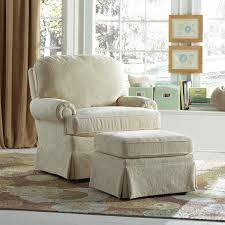 this nursery swivel glider has a traditional club chair look but moves effortlessly with the nursery chairsdining room