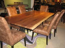 walnut live edge amish dining table with upholstered chairs by barkman on handmade dining