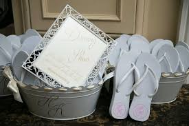Wedding reception wedding favor flip flops with monogram in bucket with  sign reading Dancing Shoes