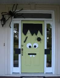 halloween front door decorationsFrankenstein monster door  Halloween party ideas Monster Doors