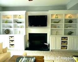 built in cabinets around fireplace painted fireplace