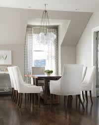 coffee stained dining table with white upholstered dining chairs