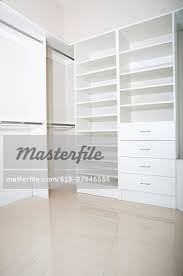 empty walk in closet. Empty Shelves And Drawers In Modern Walk-in Closet - Stock Photo Empty Walk D