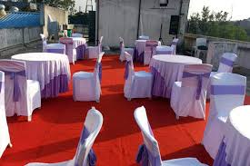 round tables with red carpet sky outdoors catering photos moshi pune caterers