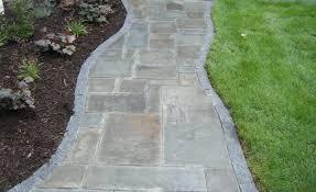 blue stone sidewalk with granite edging