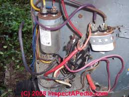 electric motor starting capacitor wiring installation starting capacitors in place on an air conditioning compressor c inspectapedia com