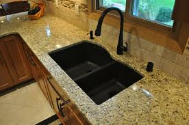 white porcelain kitchen sink combined brushed nickel faucet of