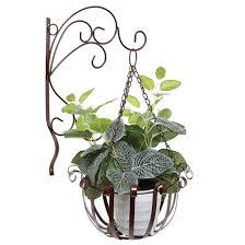 metal handing flower basket with wall