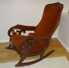 antique brown velvet rocking chair which furnished with