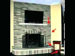 tv above fireplace hiding wires how to hide cords on wall mounted above fireplace mounting hiding