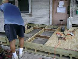 build wood patio over concrete best concrete images on cement driveways pertaining to how raise a