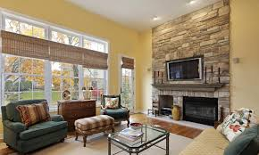 ideas for yellow living room paint colors with white brick fireplace