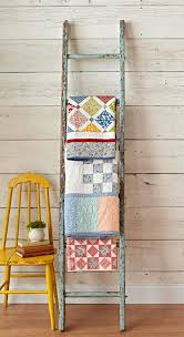 How To Give An Old Ladder A Brand New Life ‹ Ty Pennington & Repurpose an old ladder to display blankets, quilts and textiles | Ty  Pennington Adamdwight.com