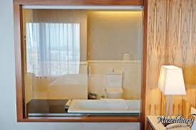 the spacious bathroom with necessary amenities the transpa glass to see through the bathroom
