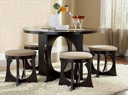 unique round chairs round dining table two glasses white flower vase comfortable carpet some plates