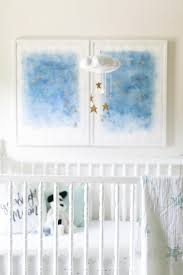gold stars nursery mobile over crib view full size