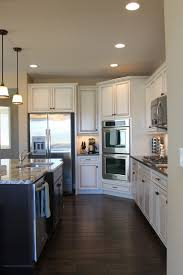 Dark Wood Floors In Kitchen Love The White Cabinets And Wide Plank Floors Favorite Places
