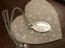 large silver dog tag pendant