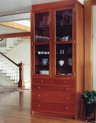 10 tall custom cherry pantry cabinet with upper glass doors