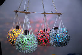 a chandelier made of recycled by the partints of the engaging youth project recycling course