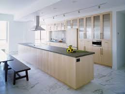 White marble floor and brown kitchen
