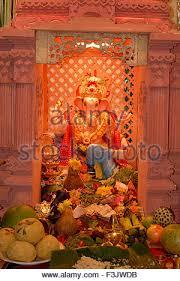 idol of lord ganesh flowers decoration in ganesh festival at