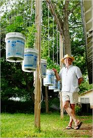donald rutledge in new braunfels tex put his buckets on pulleys to protect his plants from deer credit erich schlegel for the new york times