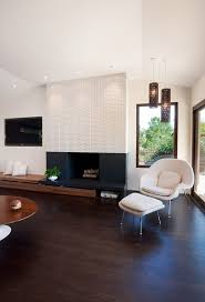 modern fireplace blending into the minimalist brown accent wall view