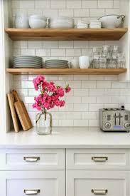 elegant wooden chandelier fixer upper open shelving in the kitchen