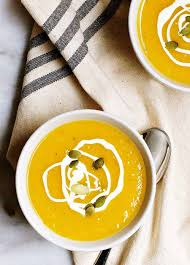 vegan ernut squash soup served in white bowls