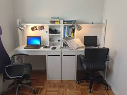 two micke work stations from ikea and clip on desk lights from home depot