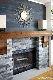 faux stone fireplace makeover spring creek colored stones looks like real but weighs less above mantel old planks are fake rock for