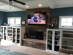 tv over fireplace installed over fireplace fireplace tv mantel ideas