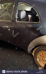 car crime criminal activity a rear nearside broken car door window