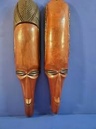 2 magnificent heavy hand carved hand painted african art wooden masks