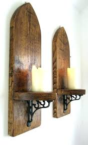 wrought iron and wood wall decor sconces iron wall sconces for candles pair of huge arch rustic solid plank wood wall wrought iron wood wall decor