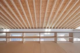 view in gallery house with exposed timber rafters bookshelf columns 7