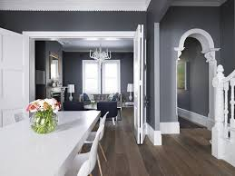 grey houses with white trim   Dark wood, gray walls and white trim. I